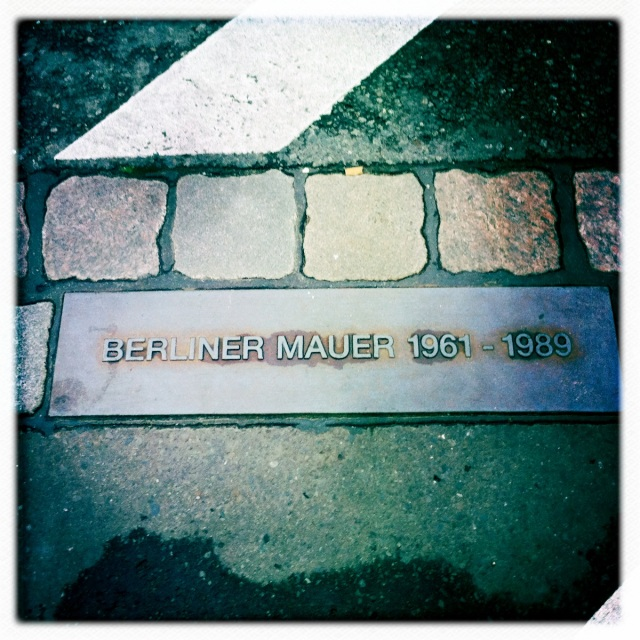 The placement of the former Berlin Wall is marked on the ground throughout the city.
