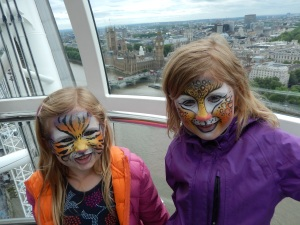 Painted faces on the London Eye
